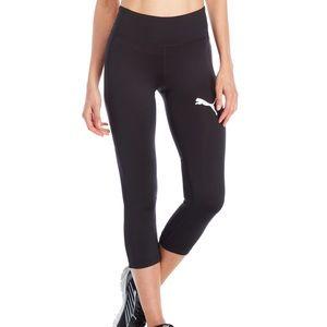Puma black leggings with mesh panels. NWT.  Sz L.
